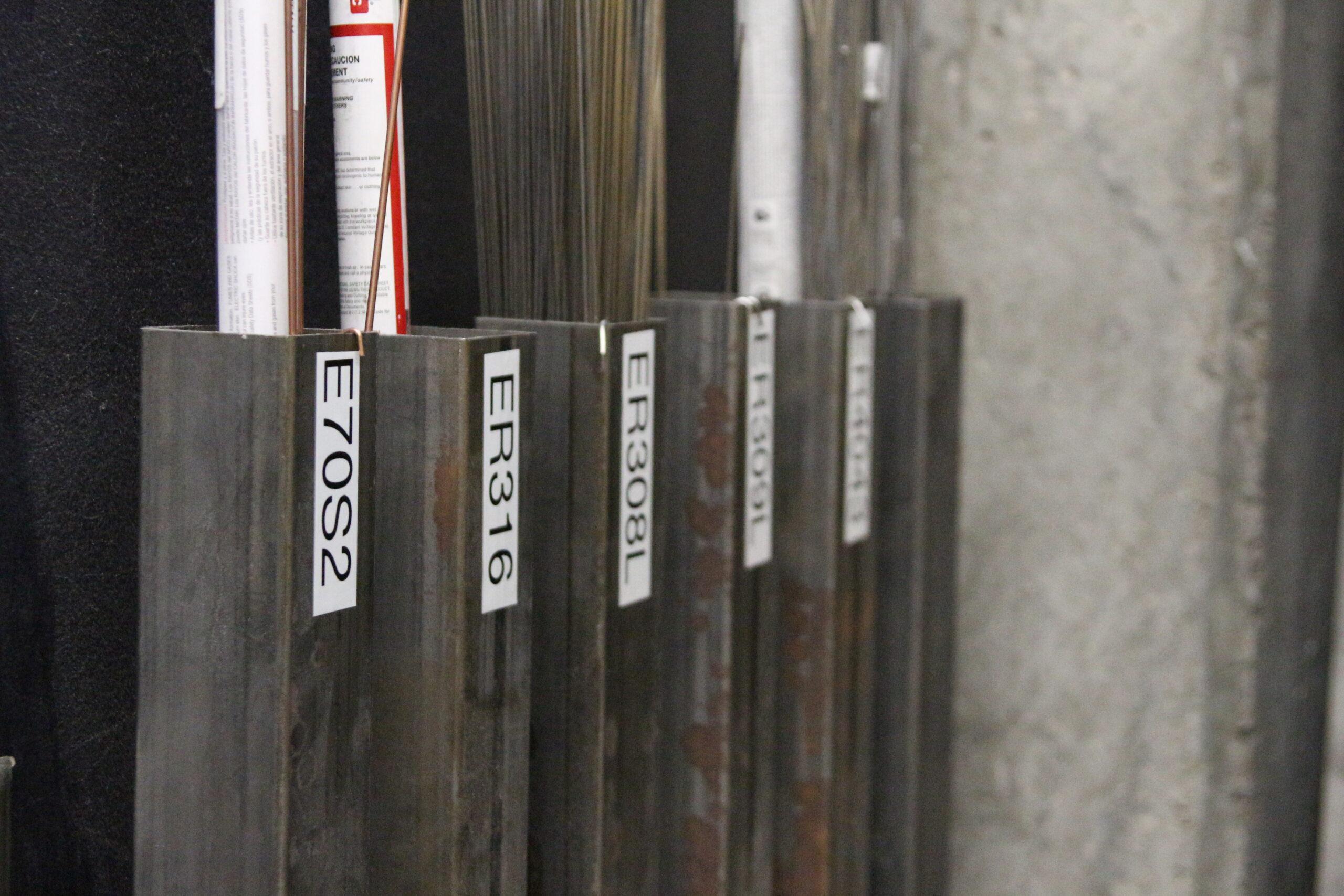 Filler material for TIG welder. E7092 visible.